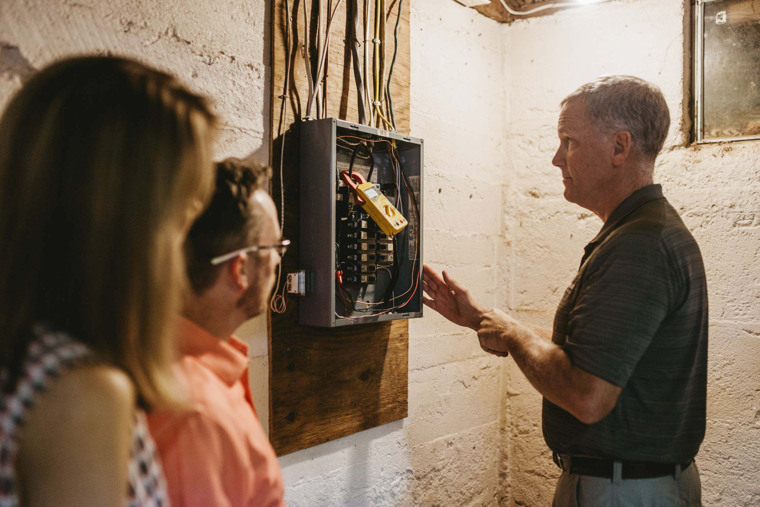 Rick Belliveau inspecting electric panel during home inspection
